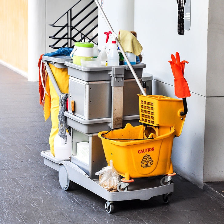 maintenance cart with cleaning supplies on it